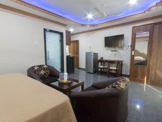 Spacious apartment with large double bed, sofas, balcony, AC, wardrobe, kitchenette, washing machine