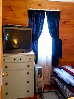 Bedroom (TV, DVD, dresser, Full size bed, oil filled heater)  AC in the window during summer months