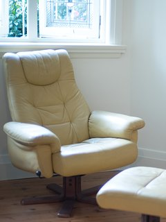 Recline in a leather chair and read a book