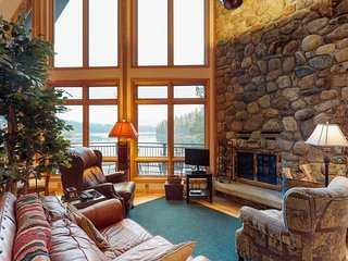 Lakefront family home w/private dock, sweeping lake views, & master jetted tub