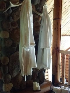 Robes and towels in master loft