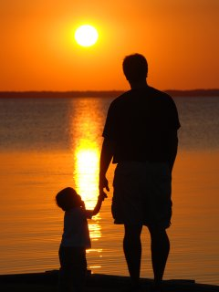 Sunset Family Photos are a great way to remember your vacation at Ocean Breeze.