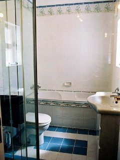 ..... ensuite with bath and shower cabinet