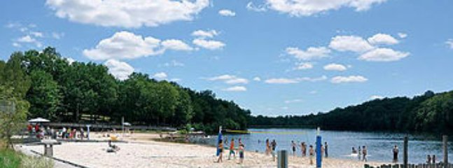 Plan d'eau Ruffiac - local lake with beach, watersports, picnic area, playground, bar & restaurant.