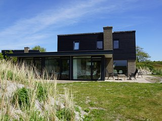 Luxe 8 persoons 'Golf Villa Texel' vlakbij zee
