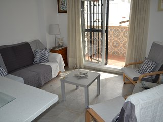 air conditioned lounge area with patio doors leading to the terrace