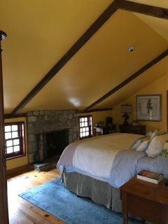 Master bedroom with king bed, fireplace, sitting area & jacuzzi ensuite bathroom