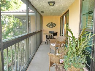 Secluded condo with two heated pools and short walk to Resident's beach