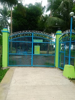 Gated Entrance with parking lot  to the right.