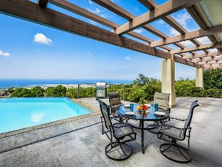 One of two outdoor dinning sets on the spacious Lanai