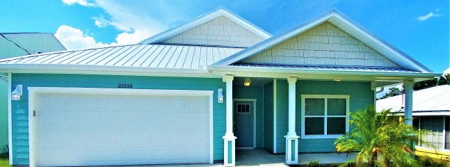 Gorgeous new 3 bed 2 bath coastal cottage, just a few blocks from the worlds most beautiful beaches.