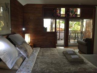 Super comfortable king size hardwood bed