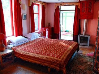 Well decorated boutique room with horse riding