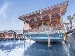 Majestic houseboat on Dal Lake, perfect for a romantic vacation