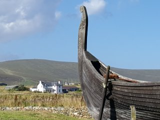A stones throw from Viking Unst.  A replica Viking house and longship. Just climb on board!
