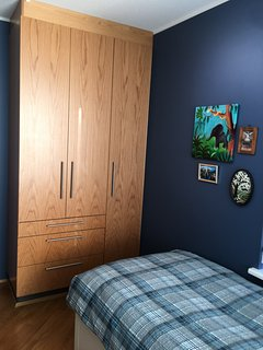 The 3rd bedroom comes with a bed which can be extended to a queen size bed. Desk and a closet also.