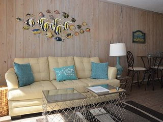 BRIGHT AND CHEERY TWO BEDROOM OCEAN FRONT CONDO STEPS AWAY FROM THE OCEAN!