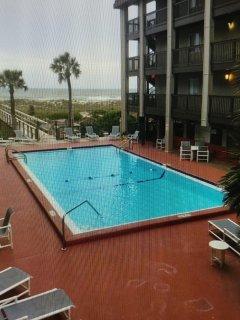 Salt water pool - Sand Dollar Villas - from front door of condo