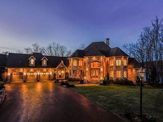 Luxury, lake front home with 5 master suites!