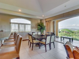 Elegant condo with private deck, ocean views & shared pool - walk to the beach!