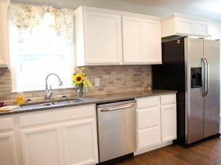 Full kitchen featuring dishwasher, fridge, freezer, stove, & microwave