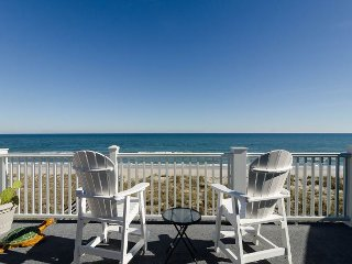 Enjoy the expansive long coastline views at this top floor oceanfront condo