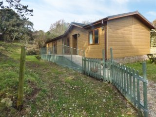 WOODPECKER LODGE, on working farm, private enclosed garden, shared private beach