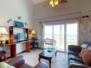 Beachfront apartment with water views, shared pool, convenient location!