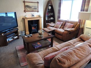 Large comfortable lounge features recliner sofas, 50' HD TV, DVD library  and Netflix.