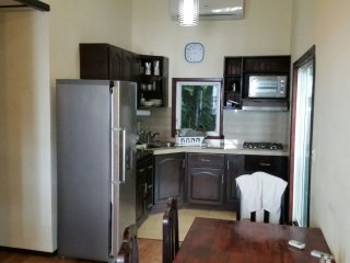 Kitchen is full sized with indoor dining close by. Note the the AC unit at the top of this picture!