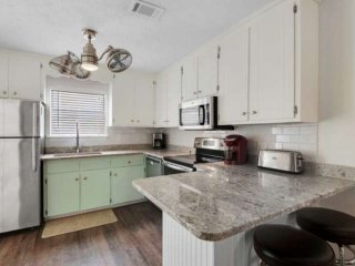 2 Bedroom Townhome Seconds From the Beach with Porch and Free Wifi