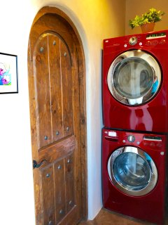 New front loading washing machine and dryer.