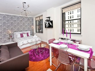 Lively + bright studio in Midtown South. Cityscape views in a LUX elevator Bldg