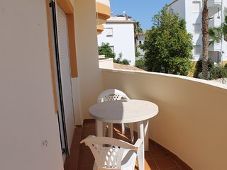 First floor apartment opposite Villamartin Plaza with communal pool