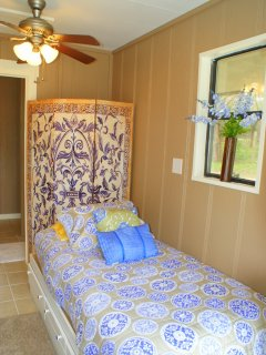 The pool house also has a twin bed for extra guests.