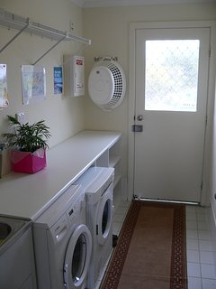 Laundry room with washing machine and dryer.