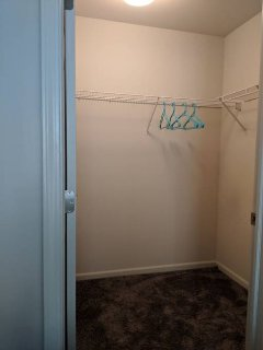 large walk in closet with hangers