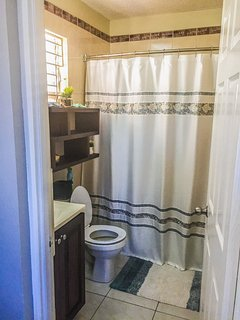 MASTER BATHROOM equipped with blow dryer and electrical outlets for shavers and styling tools