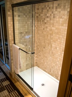 A Double Wide Ensuite Shower Stall across from the power room.
