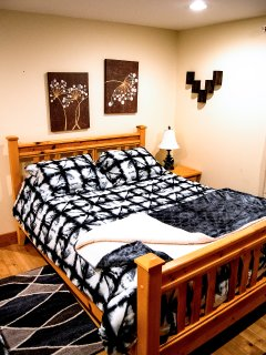 The Main Floor Master Bedroom Which Includes a Queen and Double Bed and En-suite Bathroom