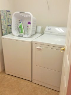Utility room with American size washing machine and drier.