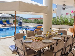 Enjoy an al fresco lunch overlooking the swimming pool
