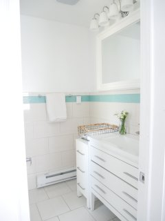 A full bathroom is available downstairs for additional privacy.