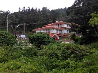 COORG YAJNA HOMES  (10 rooms with AC and non AC,can accommodate up to 40 guests)