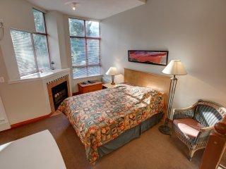 Bright Studio Condo with Cozy Fireplace and Private Balcony