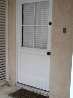Side door of the Casita with lockbox on wall.