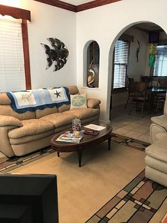 living room leading into the dining room