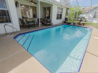 Briarwood home-caged pool w/under cover outdoor TV, seating, & dining areas w/in