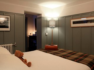 Bedroom:  lavishly panelled, a cosy haven.