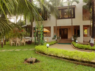 Living room and a bedroom in a well maintained luxury Villa at Nagaon, Alibaug